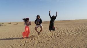 Happy jump in the desert